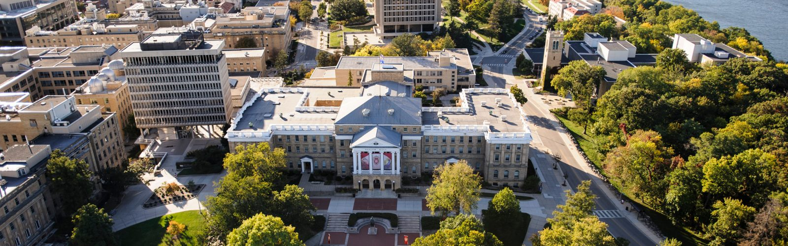 Bascom Hall, Bascom Hill and the central University of Wisconsin-Madison campus are pictured in an aerial view during autumn on Oct. 12, 2013. Clockwise from the left, major campus facilities include South Hall, Birge Hall, Van Vleck Hall, Van Hise Hall, Carillon Tower and North Hall. In the background at right is Lake Mendota. The photograph was made from a helicopter looking west. (Photo by Jeff Miller/UW-Madison)